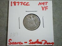 1877-CC SEATED LIBERTY DIME UNITED STATES/ SURFACE DAMAGE  {}{UNCERTIFIED}{}