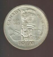 1958 CANADIAN SILVER DOLLAR IN VG GOOD SHAPE
