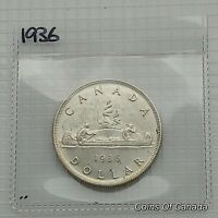 1936 CANADA SILVER DOLLAR COIN   SEALED IN AN ACID FREE HOLD