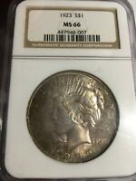 1923 PEACE DOLLAR NGC MINT STATE 66.   GOLD TONING.