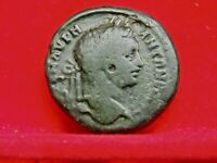 CARACALLA  LAUREATE & DRAPED CUR. BUST RIGHT. REV:COILED SER