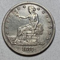 1877 S TRADE SILVER DOLLAR $1  CLEANED