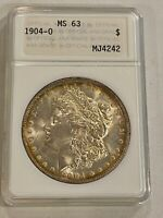 FIRST GENERATION- BEAUTIFULLY TONED, 1904-O MINT STATE 63 MORGAN SILVER DOLLAR