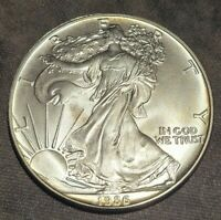 1986 AMERICAN SILVER EAGLE ASE LIGHTLY TONED REVERSE