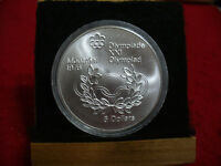 1976   MONTREAL  OLYMPICS   SILVER 5$ COIN   CANADA   RINGS AND WREATH  B.U.