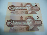 LOT OF 2  1986   CANADA TWO 2 $  DOLLAR BILL  1986  SEE PHOTOS  LOT A  AUCTION