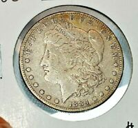 1884 S MORGAN SILVER DOLLAR IN FINE /  FINE DETAILS - SCRATCHED AS PICTURED