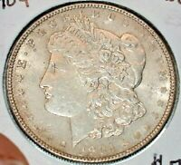 1904 MORGAN SILVER DOLLAR IN ALMOST UNCIRCULATED CONDITION