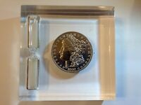 1889 O MORGAN SILVER DOLLAR ENCASED IN LUCITE. PAPERWEIGHT AND TIMER
