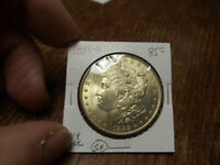 1885 O MORGAN SILVER DOLLAR CHOICE  UNC WITH A LAYER OF  GOLD TONING ON OBV