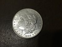 1882 MORGAN SILVER DOLLAR.