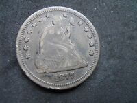 1877 SEATED LIBERTY QUARTER SILVER COIN.  VF