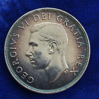 CANADA 1952 SILVER DOLLAR STILL WITH THE ORIGINAL PATINA.
