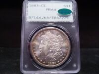 1883-CC MINT STATE 64 MORGAN SILVER DOLLAR PCGS/CAC CERTIFIED - RIM TONING/GOLD/GREEN
