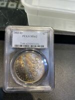 1883-O MORGAN SILVER DOLLAR PCGS CERTIFIED COIN MINT STATE 62 RAINBOW TONED.