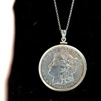 1886 MORGAN SILVER DOLLAR O WITH SS  PENDANT RIM AND 24