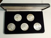 SET OF FIVE UNCIRCULATED SILVER IKE DOLLARS, 1971 TO 1976, CUSTOM DISPLAY CASE