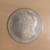 1884-S AU CLEANED MORGAN SILVER DOLLAR