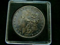 1884-S KEY DATE.  $1 MORGAN SILVER DOLLAR NATURALLY TONED