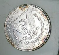 1882 O MORGAN SILVER DOLLAR - UNC, COLORFUL SPOTTED TONING, REFLECTIVE 3516