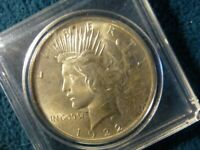 1922 PEACE DOLLAR IN BU CONDITION IN CASING
