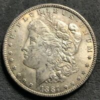 1887-O MORGAN SILVER DOLLAR. VAM 22A. DOUBLE EYE LID & PITTED REVERSE.