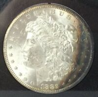 1882 CC MORGAN SILVER DOLLAR GSA NGC MINT STATE 62 WITH RAINBOW TONING WITH BOX AND COA