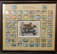 50TH ANNIVERSARY FRAMED FEDERAL DUCK STAMP COLLECTION WITH SIGNED PRINT.