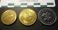 THREE DIFFERENT US EAGLE ARCADE TOKENS TWO BRASS AND ONE CU NI