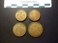 FOUR DIFFERENT CLOWN FACE US BRASS ARCADE TOKENS