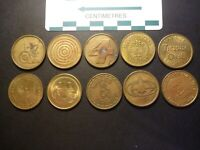 TEN DIFFERENT US BRASS ARCADE TOKENS  25 MM  SOME ARE UNCIRCULATED