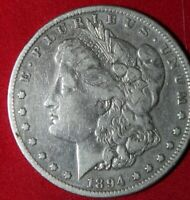 AVAILABLE IS AN 1894 S MORGAN SILVER DOLLAR.
