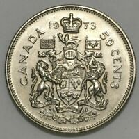 1973 CANADIAN 50 CENT COIN WITH OBVERSE STRUCK THROUGH GREASE ERROR