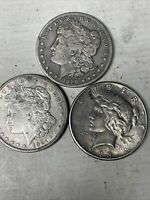 QTY LOT 3 ONE 1890 CC MORGAN ONE 1921 S MORGAN & ONE 1923 S PEACE SILVER DOLLARS