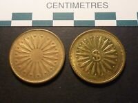 PAIR OF BRASS ARCADE OR AMUSEMENT TOKENS WITH SIMILAR DESIGNS