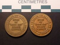 PAIR OF NATIONAL COIN ARCADE SPECIALIST TOKENS TWO DIFFERENT VERSIONS  DIES