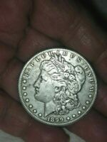 1899-O MORGAN SILVER DOLLAR - PHOTOS ARE THE DESCRIPTION