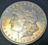 1886-P  MORGAN SILVER CHOICE UNCIRCULATED WITH GOLD TONING FROM BU ROLL.