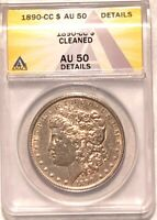 1890-CC MORGAN SILVER DOLLAR GRADED BY ANACS AS AN AU-50 DETAILS-CLEANED