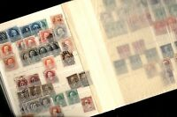 US EXCELLENT ACCUMULATION OF OLD STAMPS IN A SMALL BATTERED STOCK BOOK