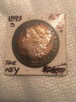 AU  KEY 1893 S MORGAN DOLLAR. STRONG STRIKE AND RAINBOW TONI