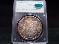 1883-CC MINT STATE 64 MORGAN SILVER DOLLAR PCGS/CAC CERTIFIED - RIM TONED/GOLD/GREEN