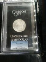 1885 CARSON CITY, PCGS MINT STATE 64 IN ORIGINAL GSA HOLDER. ONLY 228.000 MADE.
