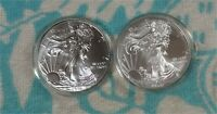 LOT OF 2   AMERICAN SILVER EAGLE 1 OZ .999 SILVER COINS IN C