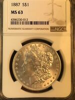 1887 P NGC MINT STATE 63 NEAR DATE, DOUBLED EAR, PINNED EAGLE, MORGAN SILVER DOLLAR