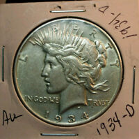 1934-D PEACE SILVER DOLLAR.  LOOKS AU BUT JUDGE FOR YOURSELF