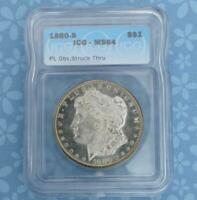 1880 S ICG MINT STATE 64 PL OBV STRUCK THRU SILVER MORGAN DOLLAR, PROOF LIKE OBVERSE