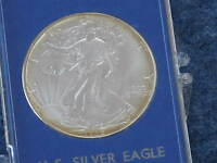 1986 AMERICAN SILVER EAGLE GEM BRILLIANT UNCIRCULATED WITH DISPLAY CASE B7466