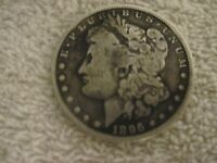 1896-O MORGAN SILVER DOLLAR. CIRCULATED UNCLEANED UNGRADED