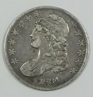 1834 SMALL DATE/ & LETTERS CAPPED BUST LETTERED EDGE SILVER 50C  FINE